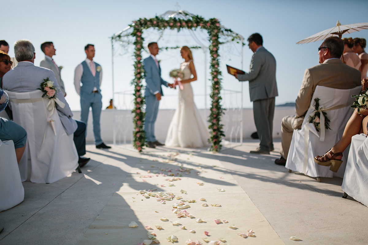 wedding ceremony outdoors rocabella santorini wedding photographer