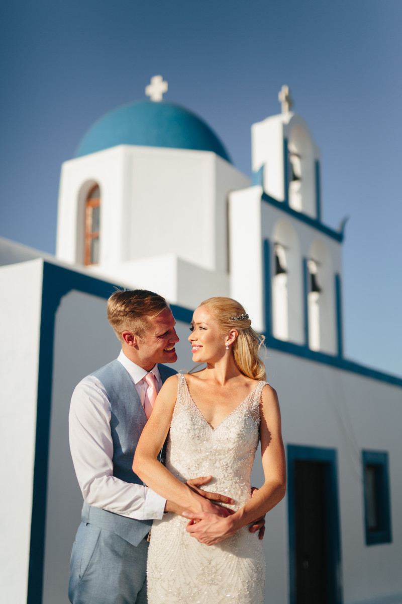 bride and groom portrait sunset rocabella santorini wedding photographer
