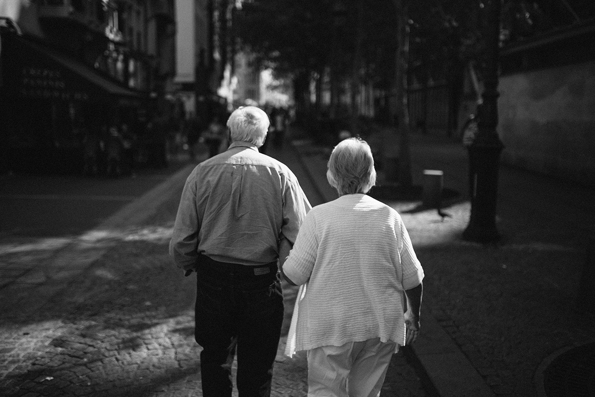 old couple stroll the sun soaked streets of paris wedding photographer