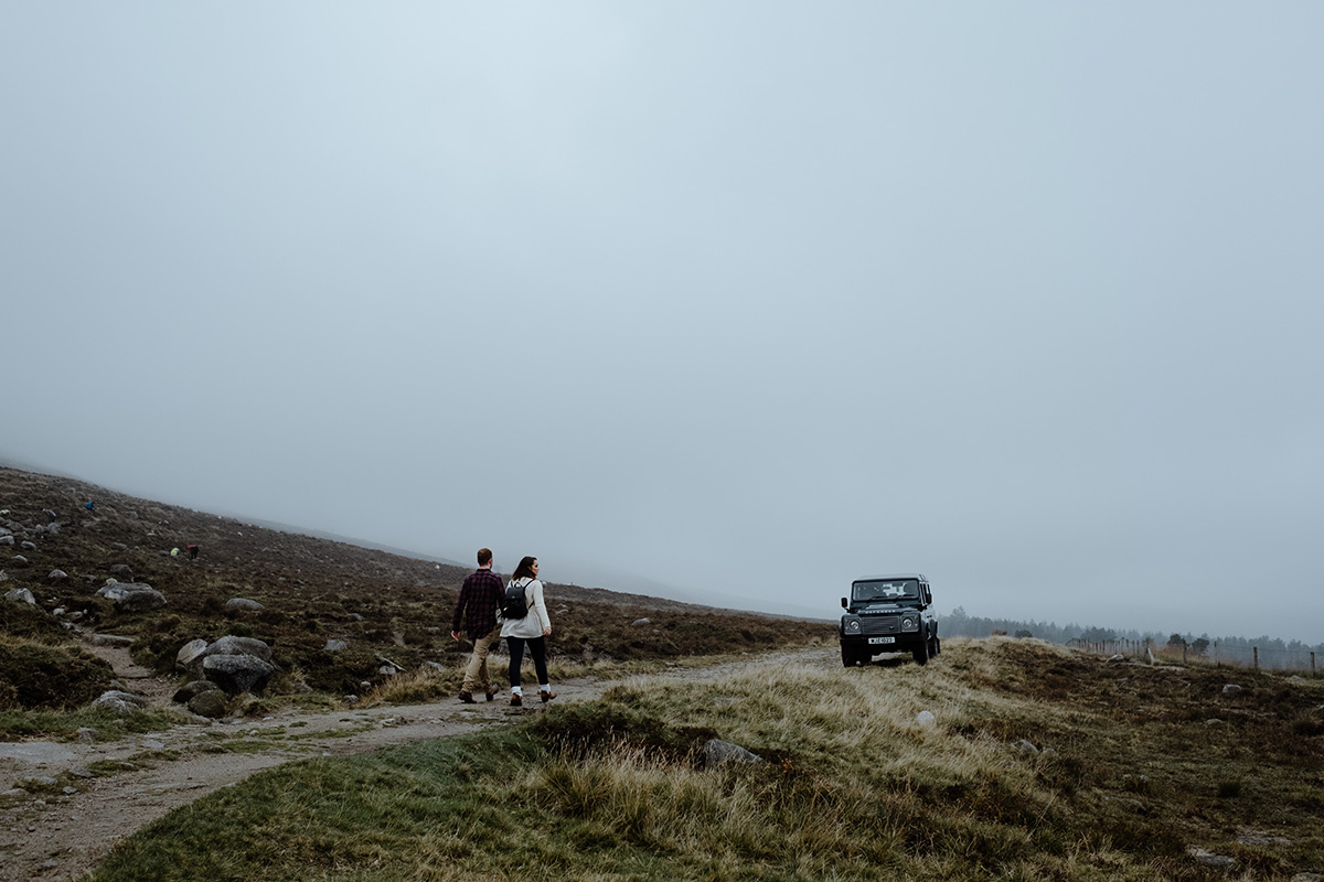 couple walking past land rover Slieve Binnian enagement shoot