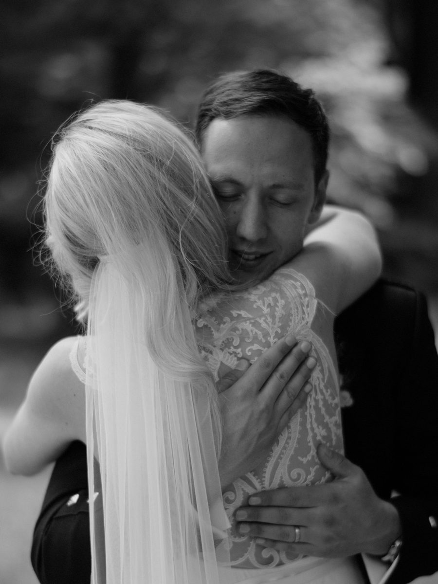 emotional hug between bride and groom Crom Castle Wedding Photographer