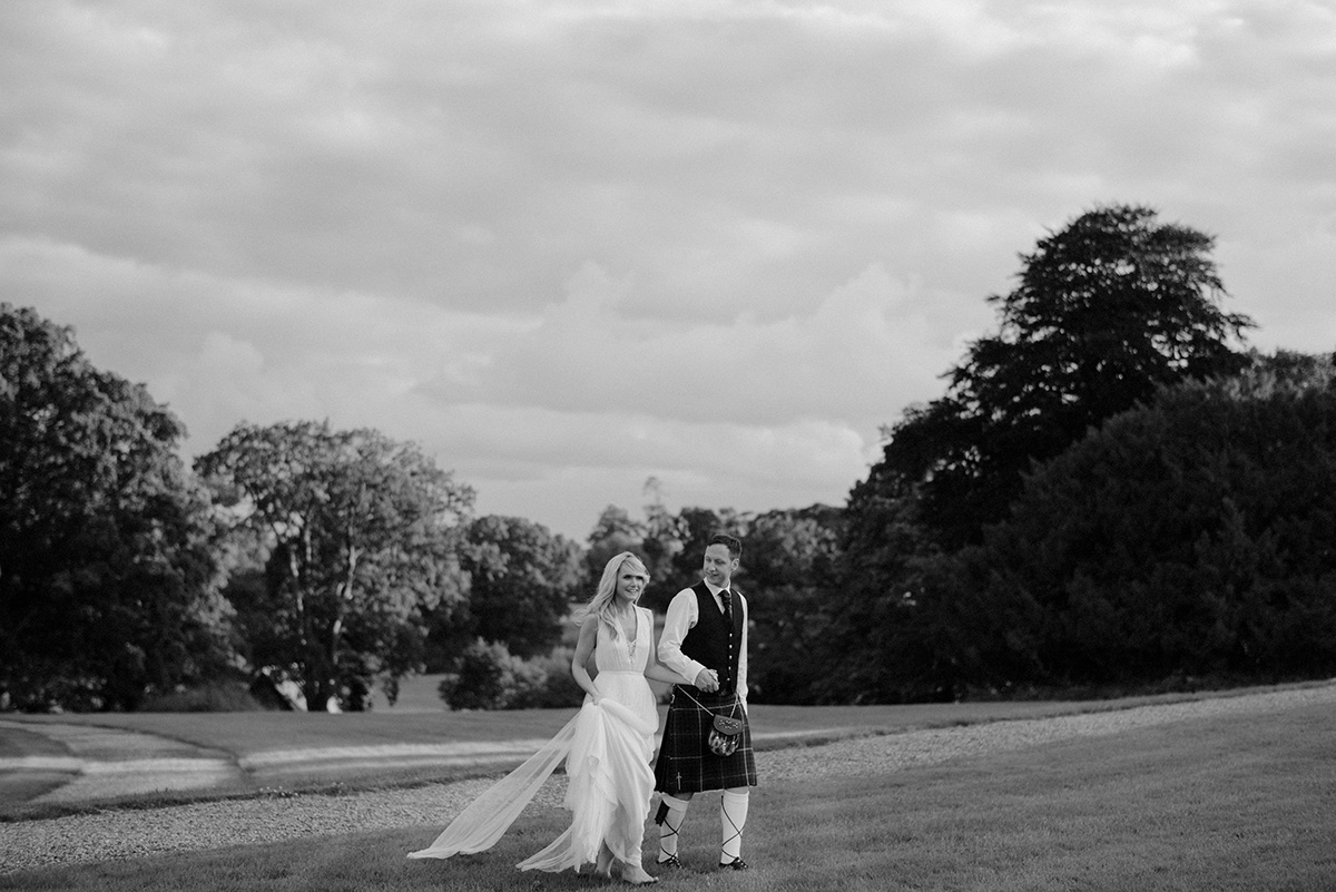 bride and groom sunset walk Crom Castle Wedding Photographer