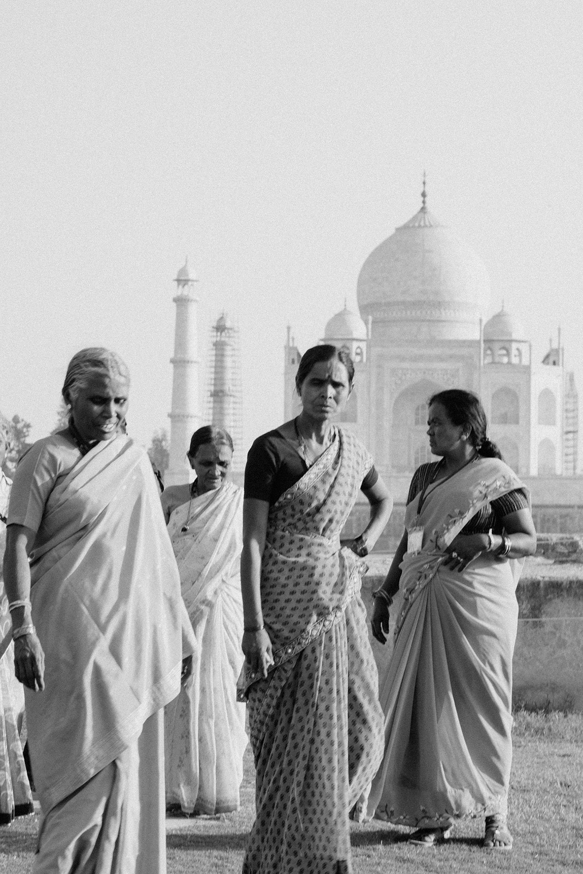 indian women in front of the taj mahal Indian wedding Photographer
