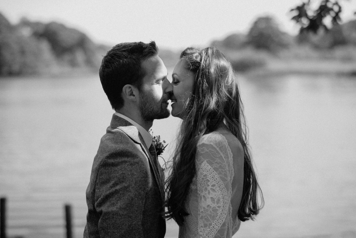 couple first kiss by lake wedding photographer finnebrogue woods