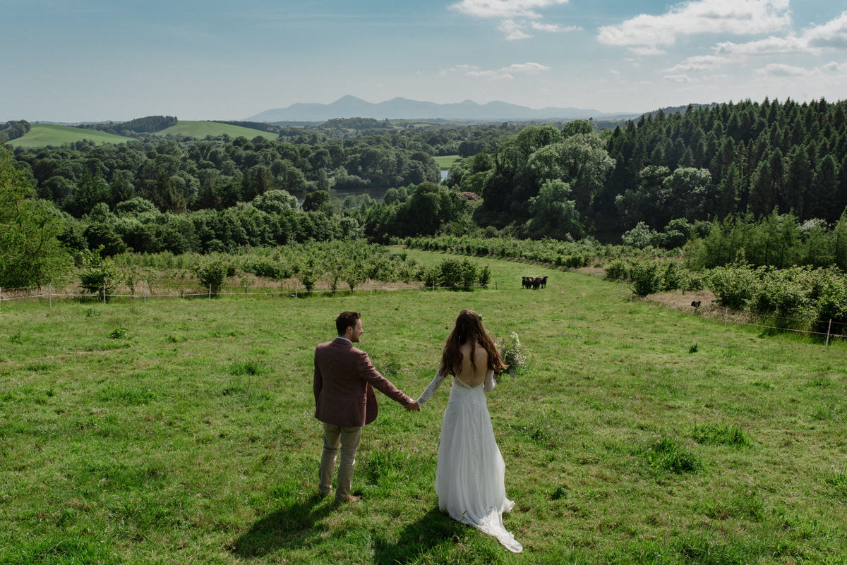 couple take in views of finnebrogue woods wedding photographer