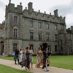 bagpipe player plays bride down the aisle borris house wedding photographer ireland
