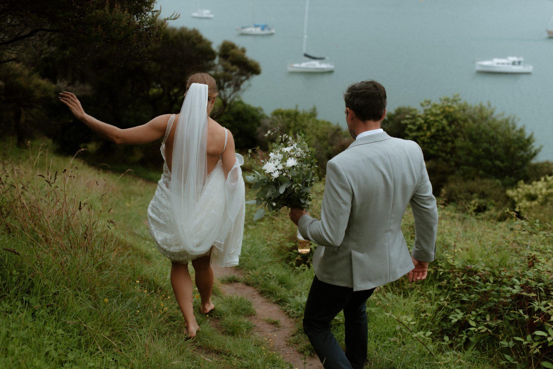 Adventurous newlyweds hike mountain destination wedding photographer