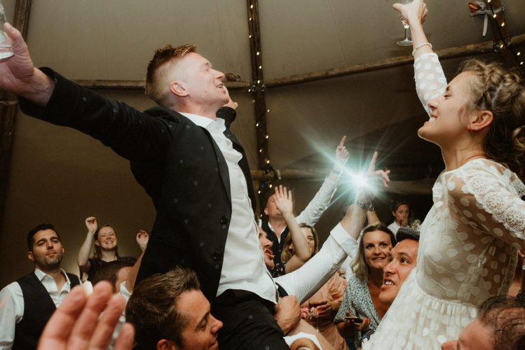 bride and groom going crazy on dancefloor epic dance floor cornwall beach wedding