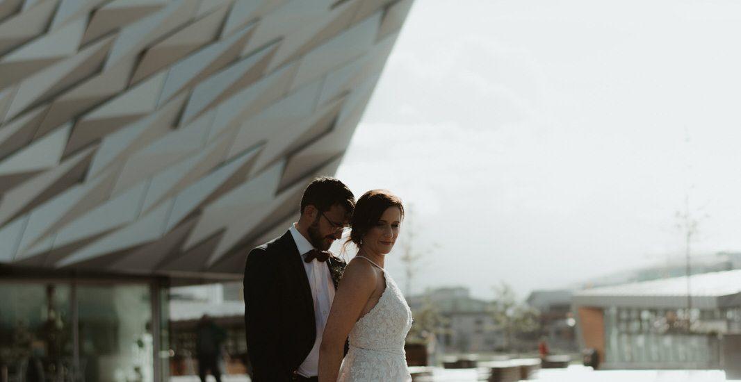 couple portrait in front of Titanic Museum Belfast