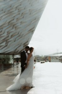couple portrait in front of Titanic Museum Belfast