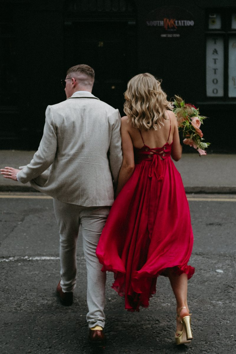 couple cross busy dublin street on wedding day humanist wedding dublin