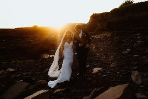 bride and groom sunset walk beach northern ireland wedding photographer