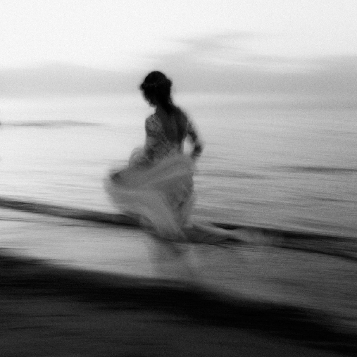 bride running barefoot along the beach motion blur documentary wedding photographer northern ireland baltic sea wedding